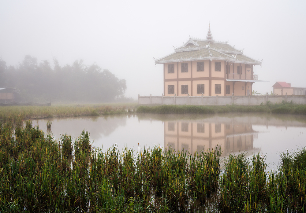 KYAING TONG, MYANMAR - CIRCA DECEMBER 2017: House on the countryside on an early foggy morning around Kyaing Tong