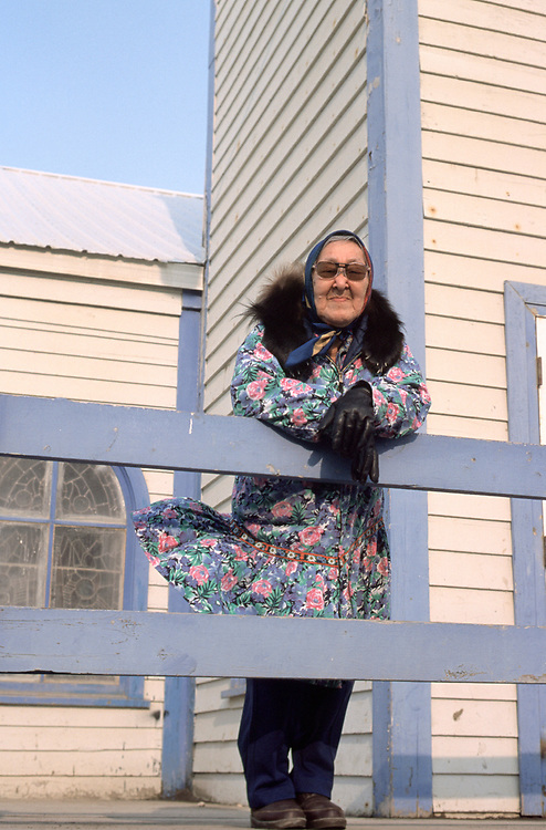 Amy Okpeaha stands outside the Presbiterian Church while waiting for the service in I&ntilde;upiaq to begin. The church is over a hundred years-old.<br /> <br /> May 18, 19:20