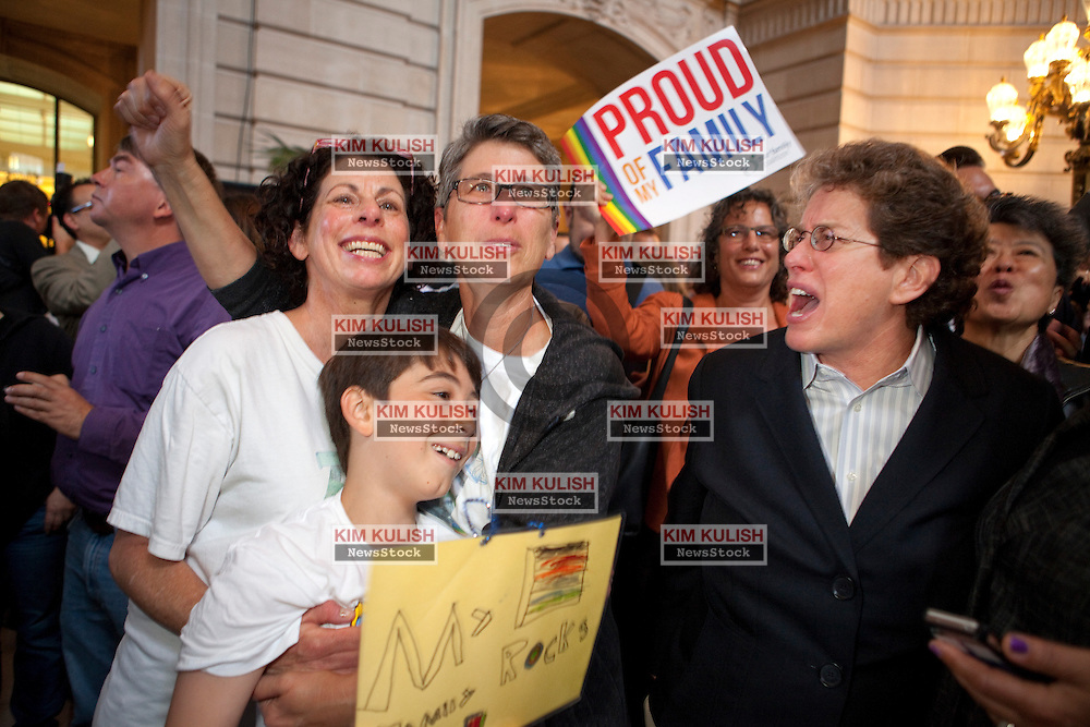 Sue Rochman, left, and Robin Romdalvik embrace  their son Maddox Rochman-Romdalvik after the the decisions  from the U.S. Supreme Court on gay marriage inside the San Francisco City Hall.  The court struck down the Defense of Marriage Act  and ruled that Proposition 8 supporters of California's ban on gay marriage, could not defend it before the Supreme Court.