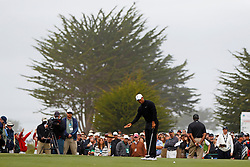 Feb 10, 2012; Pebble Beach CA, USA; Tiger Woods reacts after missing a putt on the fifth hole during the second round of the AT&T Pebble Beach Pro-Am at Monterey Peninsula Country Club. Mandatory Credit: Jason O. Watson-US PRESSWIRE