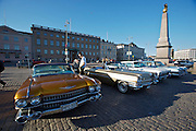 During summer from June to Septemper, every first Friday of the month is Vintage Car Cruising Night. Hundreds of classic American cars cruise around downtown Helsinki and meet at special places to have a good time, here at Kauppatori (Market Square). 1959 Cadillac DeVille sedans (l. + r.), Cadillac DeVille cabriolet (m.)