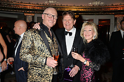 Left to right, JOHN CAUDWELL, SIR JOHN MADEJSKI and ? at a birthday dinner for Claire Caudwell for family & friends held at The Dorchester, Park Lane, London on 24th January 2014.