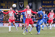 Tom Elliott of AFC Wimbledon and Tom Davies of Accrington Stanley FC tussle during the Sky Bet League 2 match between AFC Wimbledon and Accrington Stanley at the Cherry Red Records Stadium, Kingston, England on 5 March 2016. Photo by Stuart Butcher.