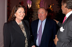 ANTHONY & ANTOINETTE OPPENHEIMER at a 'A Night in Cartier Paradise' to celebrate a new collection of jewellery by Cartier, held at The orangery, Kensington Palace, London W8 on 25th October 2005.<br />
