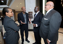 19 Oct 2011. New Orleans, Louisiana.  <br /> L/R Seletha Smith Nagin, former Mayor Ray Nagin, Michael Smith (Gen manager Hyatt New Orleans) and Chris Robertson (managing partner Poydras Hotel Members LLC) following the official reopening of the Hyatt Regency Hotel following a $275 million redevelopment. The iconic hotel became a symbol of hurricane Katrina when all the glass was blown from her facade. Nagin's administration temporarily took over the hotel as their headquarters in the immediate aftermath of the storm. Over 6 years later the all new, ultra modern 1,193 room hotel and conference center adjacent the Mercedes Benz Superdome is once again open for business.<br /> Photo; Charlie Varley/varleypix.com