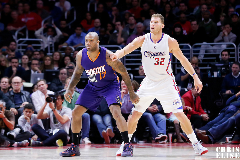 08 December 2014: Phoenix Suns forward P.J. Tucker (17) defends on Los Angeles Clippers forward Blake Griffin (32) during the Los Angeles Clippers 121-120 overtime victory over the Phoenix Suns, at the Staples Center, Los Angeles, California, USA.
