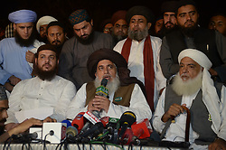 November 2, 2018 - Lahore, Punjab, Pakistan - Pakistani  head of the Tehreek-e-Labaik Pakistan (TLP)Khadim Hussain Rizvi (C) a hardline religious political party, raises hands with others as he speaks to media during a press conference. (Credit Image: © Rana Sajid Hussain/Pacific Press via ZUMA Wire)