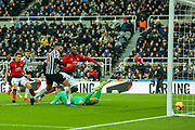 Romelu Lukaku (#9) of Manchester United scores Manchester United's first goal (0-1) after the ball is spilled by Martin Dubravka (#12) of Newcastle United during the Premier League match between Newcastle United and Manchester United at St. James's Park, Newcastle, England on 2 January 2019.