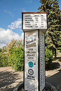 The city center mile marker showing distances to other places in Golden Heart Plaza downtown Fairbanks, Alaska.