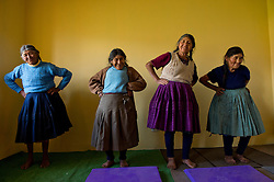 Physical therapy is part of the Peruvian's government program for elderly 65 and older. Here women attend a session in Chara, San Pablo, Cusco.