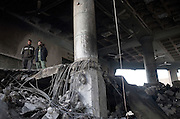 Palestinian men survey the destruction inside the bombed out interior of Al Abrar mosque in downtown Rafah, Gaza January 15, 2009. Al Abrar, the largest mosque in Rafah was targeted by the Israeli Air Force in the early hours of Thursday morning presumably for alleged weapons or explosive caches stored at the site, a claim local Palestinians dispute. Photo by Scott Nelson/World Picture Network for the New York Times.