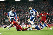 Liverpool forward Sadio Mane (10) goes down under the challenge during the Premier League match between Liverpool and Brighton and Hove Albion at Anfield, Liverpool, England on 30 November 2019.