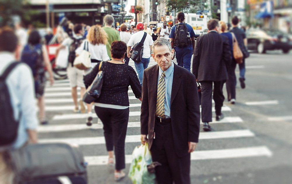 Look of uncertainty on mans face in the middle of the street. NYC 2011