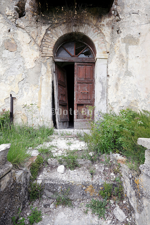 old broken down door with stairs leading to it