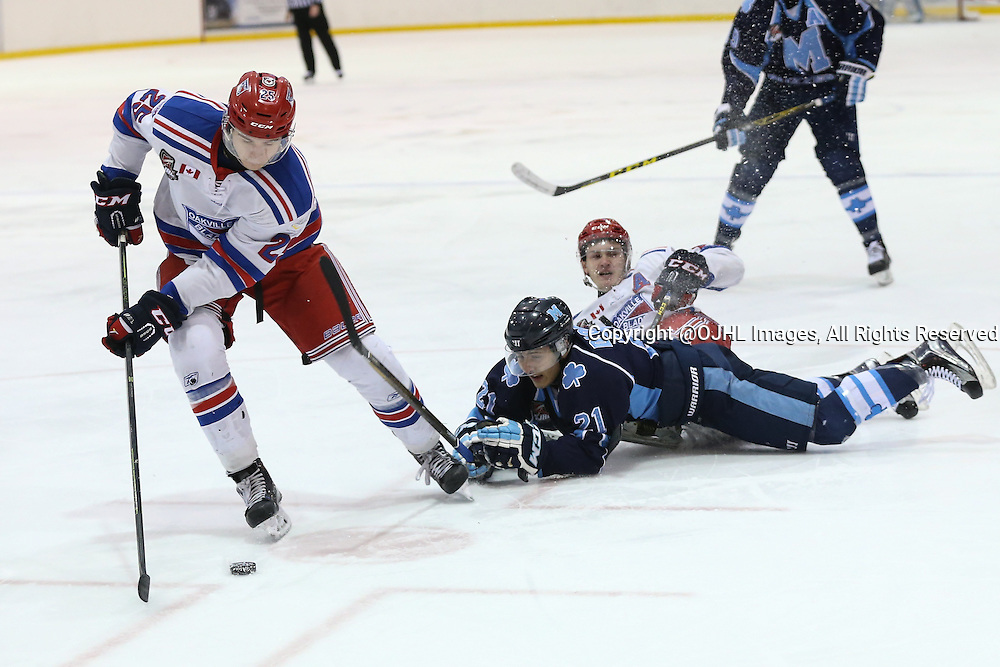 Oakville, ON - MAR 4, 2016  Ontario Junior Hockey League game action between St. Michael's and Oakville Blades at the Sixteen Mile Sports Complex Oakville, ON. A.J. D'Orazio #21 of the St.Michael's Buzzers attempts to hit the puck from Ian Blacker #25 of the Oakville Blades during the first period. <br /> (Photo by Kevin Sousa / OJHL Images)