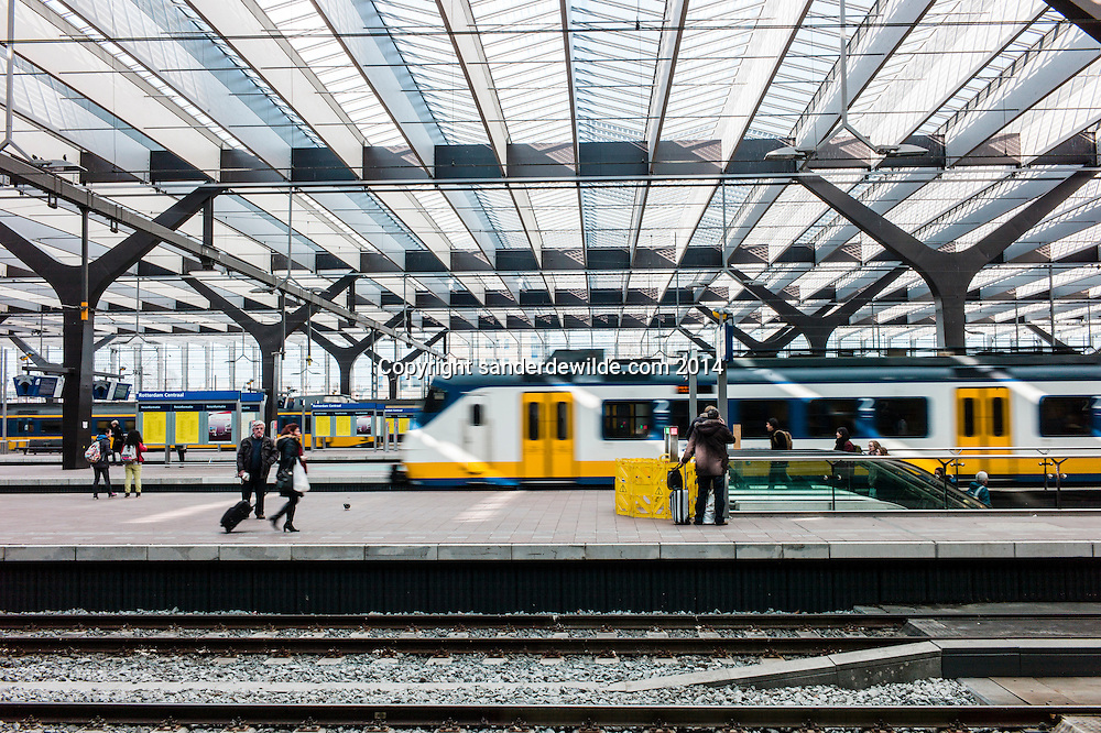 Rotterdam central station has been redeveloped. new glass roof with trains. A collaboration of  benthem crouwel architects, MVSA architects and west 8 architects.