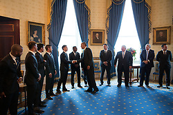 President Barack Obama greets the players and leadership of Sporting Kansas City prior to an event to welcome the team and honor their victory in the 2013 MLS Cup Championship, in the Blue Room of the White House, Oct. 1, 2014. (Official White House Photo by Pete Souza)<br /> <br /> This official White House photograph is being made available only for publication by news organizations and/or for personal use printing by the subject(s) of the photograph. The photograph may not be manipulated in any way and may not be used in commercial or political materials, advertisements, emails, products, promotions that in any way suggests approval or endorsement of the President, the First Family, or the White House.