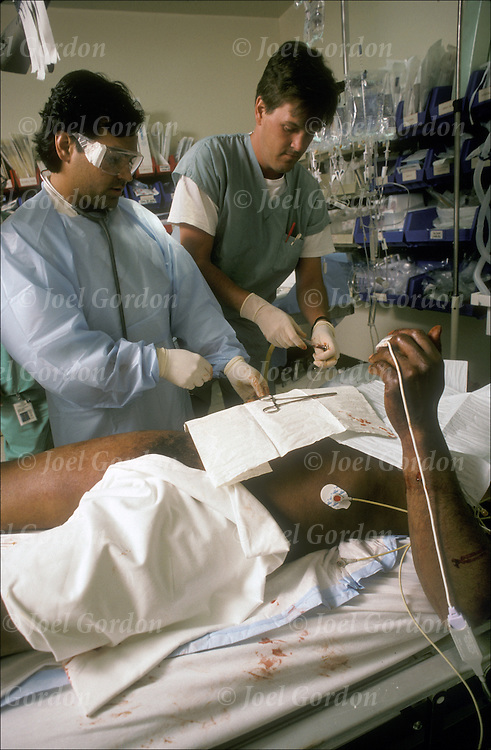 Friday night, blood being drain from a finger into a capillary tube in the trauma room, Emergence Room scene ER doctors treating gunshot victim in Lincoln Medical & Mental Health Center in the South Bronx, NY.