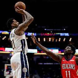 Dec 6, 2017; New Orleans, LA, USA; Denver Nuggets forward Wilson Chandler (21) shoots over New Orleans Pelicans guard Jrue Holiday (11) during the first quarter at the Smoothie King Center. Mandatory Credit: Derick E. Hingle-USA TODAY Sports