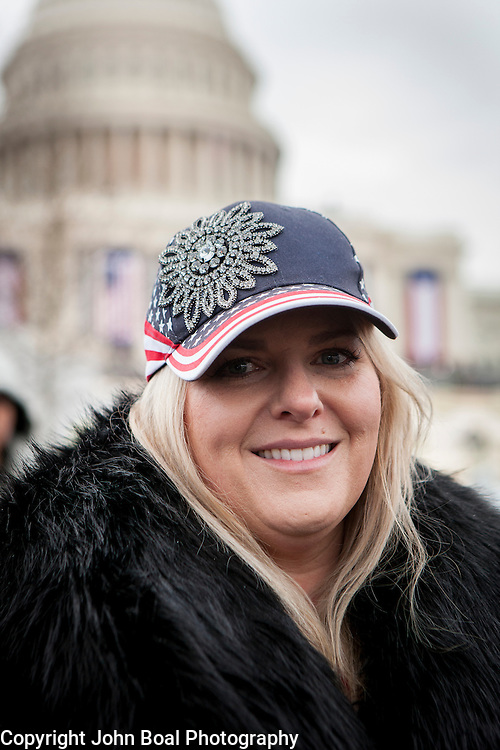 "Laura Pickett, traveled to D.C to attend the Inauguration of Donald Trump as the 45th President of the United States, January 20, 2017.  She expressed hopes that ""...there's a political reset...I hope America is first again...this [country] went too far in one direction and I hope we can move back toward the center...""  She admitted to hoping President Obama would've delivered on some of his promises, ""...but it didn't happen...I don't want a wall, but I do want more border security..."" .  John Boal Photography"