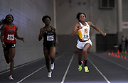 Feb 24, 2017; Seattle, WA, USA; Kyra Constantine of Southern California wins women's 200m heat in 24.04 during the MPSF Indoor Championships at the Dempsey Indoor. From left: Marie Veale (Cal State Northridge) and Suzie Acolatse (UCLA).