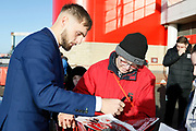 Middlesbrough midfielder Lewis Wing (26) signing autographs during the EFL Sky Bet Championship match between Middlesbrough and Ipswich Town at the Riverside Stadium, Middlesbrough, England on 29 December 2018.