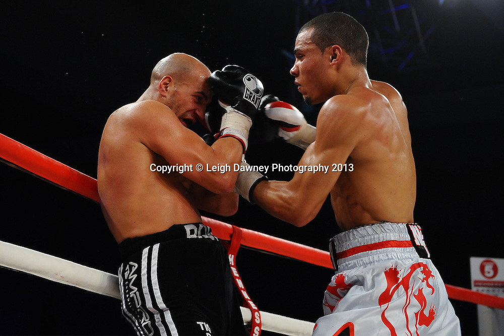 Chris Eubank Jnr forces Frankie Borg against the ropes in a Middleweight contest. Glow, Bluewater, Kent, UK. Hennessy Sports © Leigh Dawney Photography 2013.