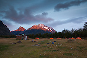 Alpenglow on the mountains behind Refugio Dickson in Torres del Paine National Park, Chile.