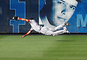 Boston center fielder Coco Crisp makes a diving catch during the game between the Atlanta Braves and the Boston Red Sox at Turner Field in Atlanta, GA on June 19, 2007..