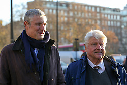 © Licensed to London News Pictures. 04/12/2019. London, UK. Parliamentary Conservative candidate for Richmond Park and North Kingston and former Tory candidate for Mayor of London ZAC GOLDSMITH (L) and  Author and father of the Prime Minister BORIS JOHNSON, STANLEY JOHNSON (R) attend the unveiling of life-sized herd of 21 bronze elephants at Marble Arch. The sculpture is the largest such depictionof an elephant herd in the world and is intended to draw attention to the plight of this species that could be extinct on current trends, by 2040. Each elephant in the sculpture is modelled after a real orphaned animal currently in the care of the Sheldrick Wildlife Trust. Left behind by poachers and other sources of human-wildlife conflict these animals have been raised by the trust in an effort to secure the future of the species. The herd will be displayed until 4 December 2020. Photo credit: Dinendra Haria/LNP