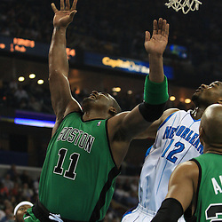 11 February 2009:  Boston Celtics forward Glen Davis (11) shoots over New Orleans Hornets center Hilton Armstrong (12) during a NBA game between the Boston Celtics and the New Orleans Hornets at the New Orleans Arena in New Orleans, LA.
