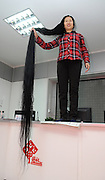TAIYUAN, CHINA - OCTOBER 23:  China Out - Finland Out<br /> <br /> 2.5-meter Long Hair In China<br /> <br /> 57-year-old Ni Linmei shows her more than 2.5-meter long hair on October 23, 2013 in Taiyuan, Shanxi Province of China. Ni has kept her hair for 17 years. <br /> ©Exclusivepix