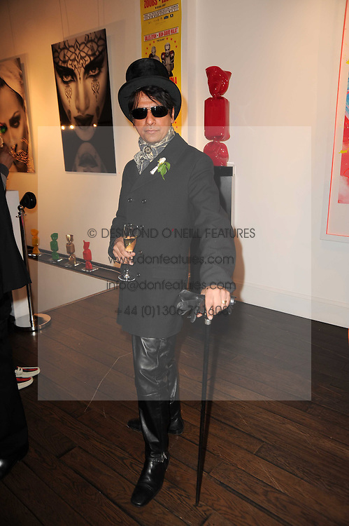 ROBIN DUTT at a private view of an exhibition of work by artists Zoobs and Lodola held at The Opera Gallery, 134 New Bond Street, London on 16th June 2010.