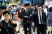 HONG KONG - APRIL 13: Crowds of customers and white-collars cross the street in Central business district, on April 13, in Hong Kong. (Photo by Lucas Schifres/Pictobank)