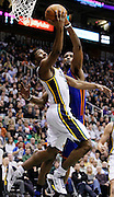 Utah Jazz guard Ronnie Price, left, attempts to score against New York Knicks forward Shawne Williams, right, during the second half of an NBA basketball game in Salt Lake City, Wednesday Jan. 12, 2011. The Jazz defeated the Knicks 131-125. (AP Photo/Colin E Braley)