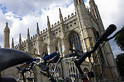 "Parked bikes belonging to students of King's College Cambridge. King's College is a constituent college of the University of Cambridge, England. The college's full name is ""The King's College of our Lady and Saint Nicholas in Cambridge"", but it is usually referred to simply as ""King's"" within the University. The college was founded in 1441 by King Henry VI, soon after its sister college in Eton. However, the King's plans for the college were disrupted by the civil war and resultant scarcity of funds, and his eventual deposition. Little progress was made on the project until in 1508 King Henry VII began to take an interest in the college, most likely as a political move to legitimise his new position. The building of the college's chapel, begun in 1446, was finally finished in 1544 during the reign of King Henry VIII. King's College Chapel is regarded as one of the greatest examples of late Gothic English architecture. It has the world's largest fan-vault, and the chapel's stained-glass windows and wooden chancel screen are considered some of the finest from their era. The building is seen as emblematic of Cambridge. The chapel's choir, composed of male students at King's and choristers from the nearby King's College School, is one of the most accomplished and renowned in the world. Every year on Christmas Eve the Festival of Nine Lessons and Carols (a service created by a Dean of King's especially for the college) is broadcast from the chapel to millions of listeners worldwide."