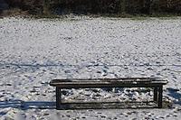 Bench and snow, Kilbogget Park in suburban in Dublin Ireland