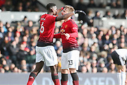 GOAL - Manchester United Midfielder Paul Pogba celebrates with Manchester United Defender Luke Shaw 0-3 during the Premier League match between Fulham and Manchester United at Craven Cottage, London, England on 9 February 2019.