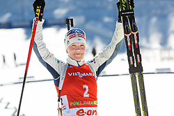 Second placed MAKARAINEN Kaisa of Finland celebrates during flower ceremony after the Women 12.5 km Mass Start competition of the e.on IBU Biathlon World Cup on Sunday, March 9, 2014 in Pokljuka, Slovenia. Photo by Vid Ponikvar / Sportida