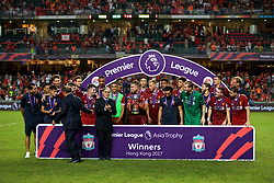 HONG KONG, CHINA - Saturday, July 22, 2017: Brian Leung and Timothy Fok Tsun-ting present Liverpool's captain Jordan Henderson with the trophy after the Premier League Asia Trophy final match between Liverpool and Leicester City at the Hong Kong International Stadium. (Pic by David Rawcliffe/Propaganda)