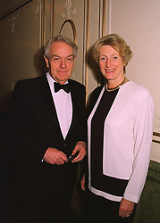 SIR NICHOLAS & the HON.LADY SCOTT at a reception in London on 1st April 1998.MGM 20