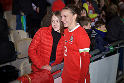 NEWPORT, WALES - Thursday, April 4, 2019: Wales' captain Loren Dykes poses for a photograph with a supporter after an International Friendly match between Wales and Czech Republic at Rodney Parade. The game ended in a 0-0 draw. (Pic by David Rawcliffe/Propaganda)
