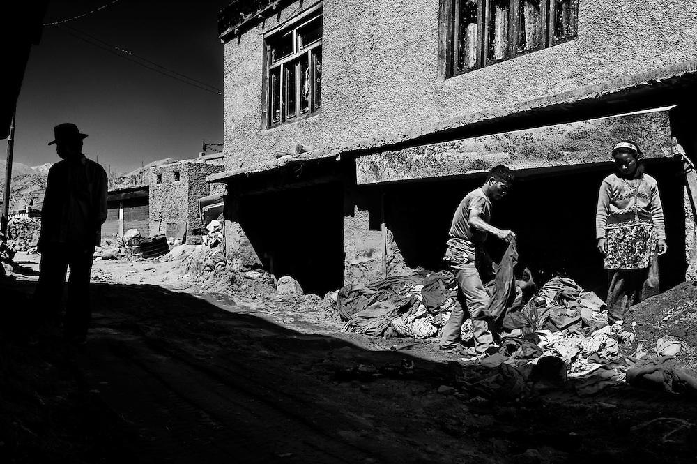 People working very hard in rebuilding the place after it was hit by flash floods following a cloudburst on 6th Aug. 2010.<br /> Choglamsar town near Leh, Ladakh.