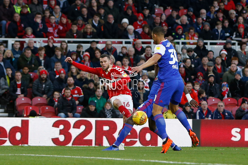 Middlesbrough midfielder Jonathan Howson (16) gets a cross in during the EFL Sky Bet Championship match between Middlesbrough and Ipswich Town at the Riverside Stadium, Middlesbrough, England on 29 December 2018.