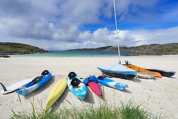 Boats on beach at Achmelvich in Assynt, Sutherland, North West Scotland