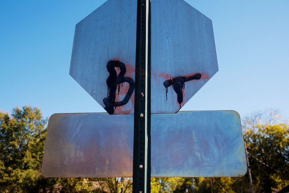 "A graffitied stop-sign shows the initials for the Baptist Town neighborhood of Greenwood, Mississippi on Saturday, November 6, 2010. Considered ""the hood"", this neighborhood has long struggled with the cycle of poverty, crime and violence."