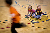 JEROME A. POLLOS/Press..Christian Horton, right, and Makenzie Pickles watch from their spot on Saturn as their second grade classmates at Seltice Elementary race to see how many trips they can make from the sun to Neptune during a science exercise Thursday prepared by University of Idaho Coeur d'Alene teacher education students.