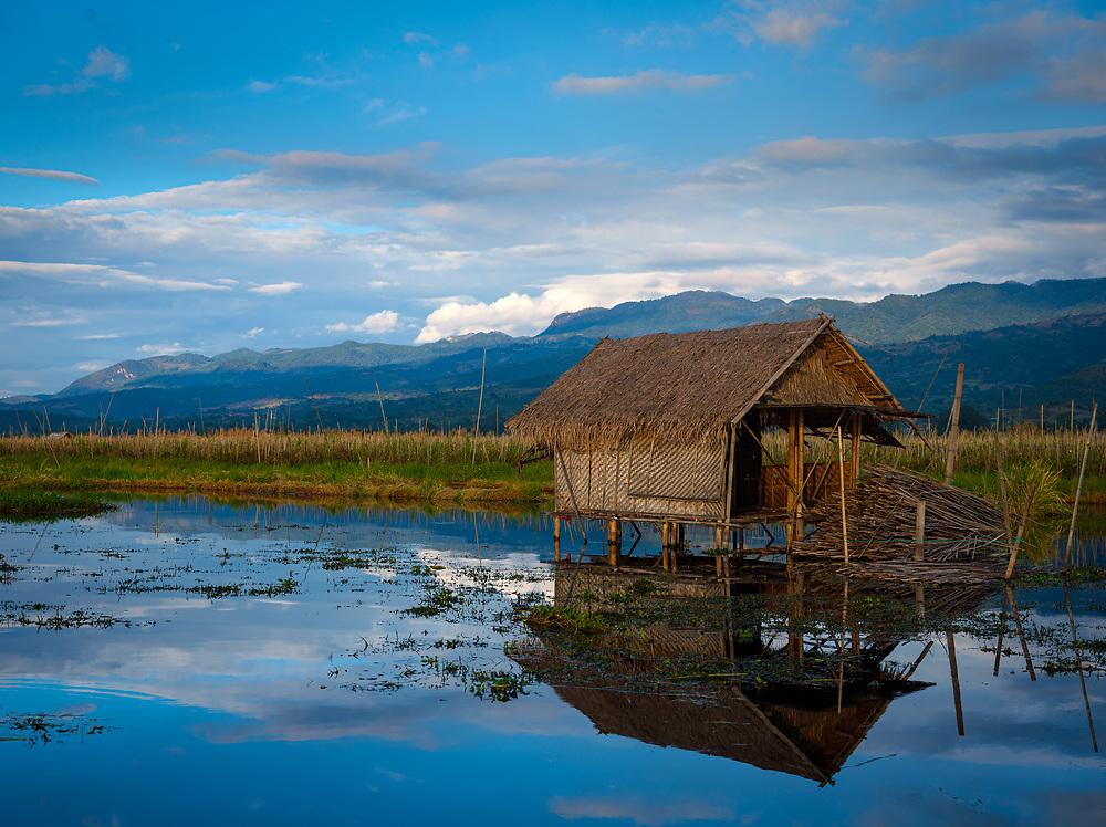 INLE LAKE, MYANMAR - CIRCA DECEMBER 2017: Typical hut built on stilts in Inle Lake, Myanmar