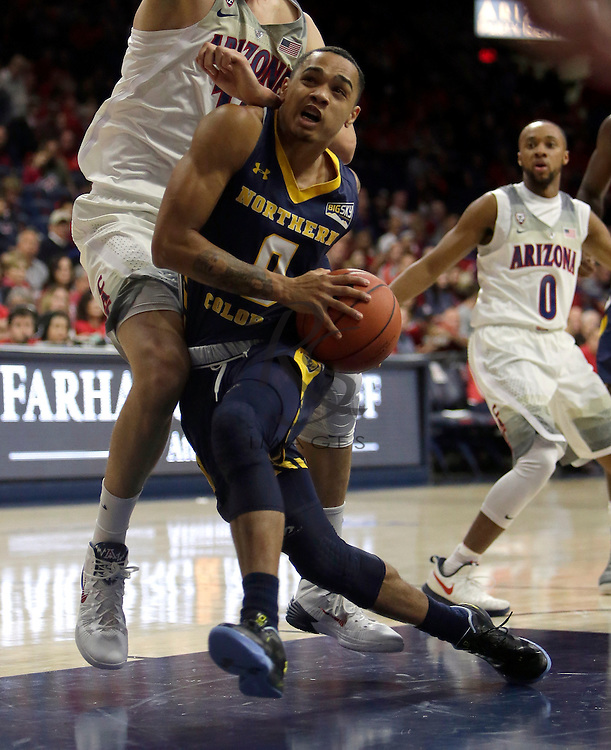 Northern Colorado guard Jordan Davis (0) during the first half of an NCAA college basketball game against Arizona, Monday, Nov. 21, 2016, in Tucson, Ariz. (AP Photo/Rick Scuteri)