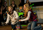 Nick Pronin, 11 and Amanda Gordon compete against each other during Double Dare, a family television style game set up at Baker Center during Sibs Fest. The event, which featured a magician, games, karaoke, and etc., was organized by the UPC (University Program Council). The two, who are not related, were visiting their siblings at the university.